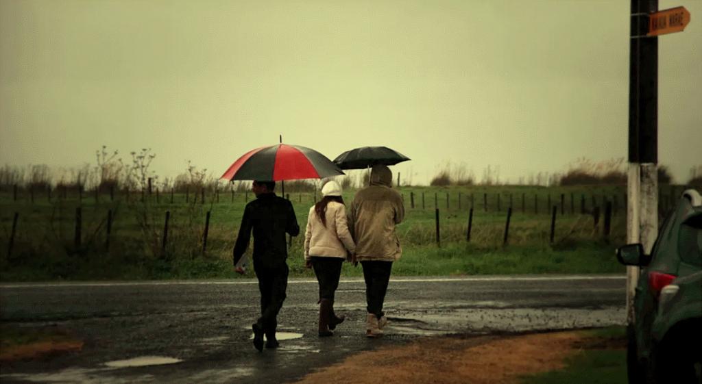 Mourners walking to urupā